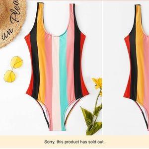 Fun striped one-piece suit! 🌈